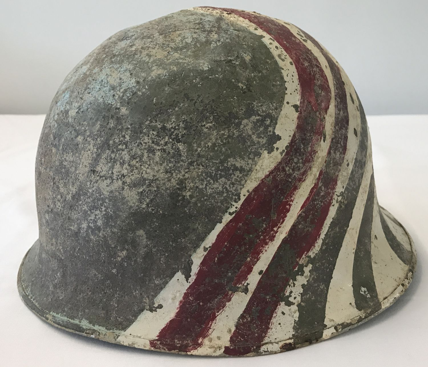 A French M51 OTAN (NATO) steel helmet with hand painted markings.