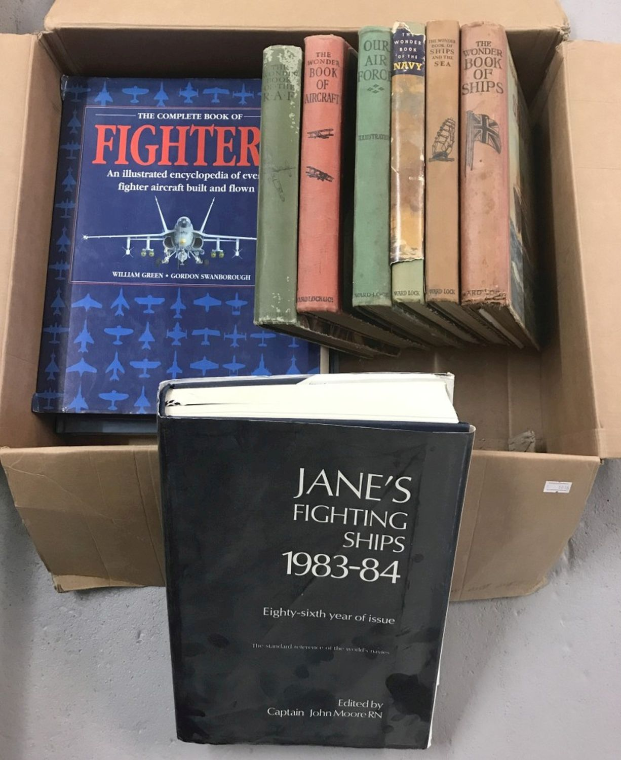 Lot 176 - A collection of military related books to include Jane's Fighting Ships 1983-4.