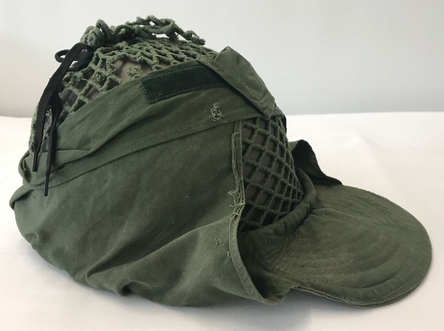 Lot 96 - A 1937 pattern Swedish helmet with canvas and string peaked cover.