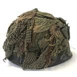 A Belgian Army OTAN M1951 steel helmet, US M1 style, circa 1985. With net and scrim.