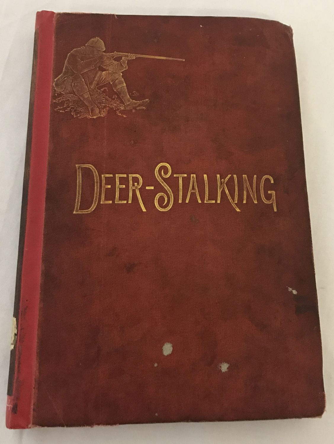 """Lot 185 - An 1886 first edition of """"Deer-Stalking"""" by Augustus Grimble. Original cover front and back."""