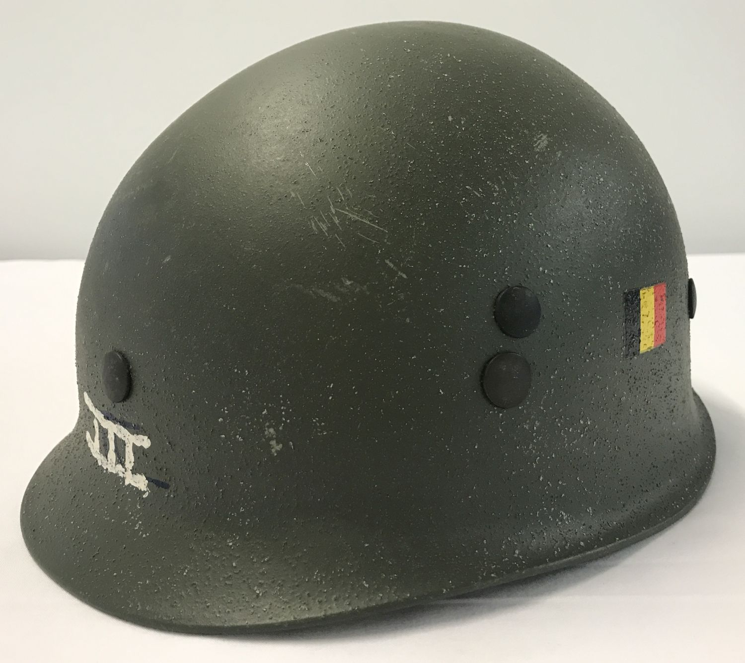 Lot 108 - A Belgian M71 paratroop helmet with handpainted decals to front and side.