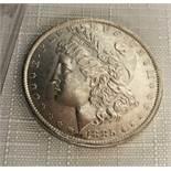 An 1885 USA silver morgan dollar, 0.865 ozt.