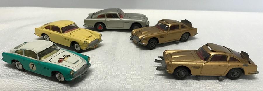 Lot 19 - Corgi Aston Martin diescast cars, 2 x DB4, 3 x DB5 James Bond Cars. Playworn.