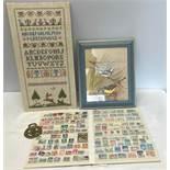 Needlework sampler, framed print of birds, World and British stamp album and Winston a Churchill