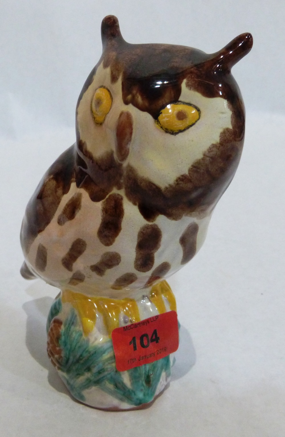 A Crannog pottery owl, glazed and painted in colours. Impressed marks. 7' high