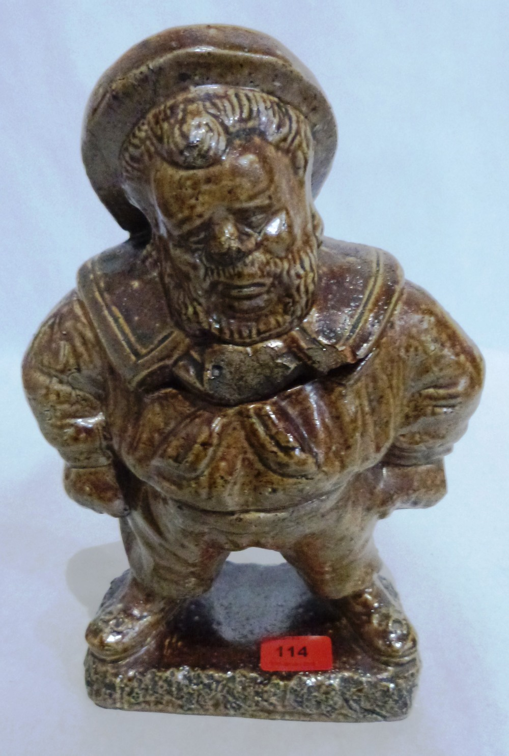 A 19th century salt glazed figural tobacco jar. 13' high. Chips to cover