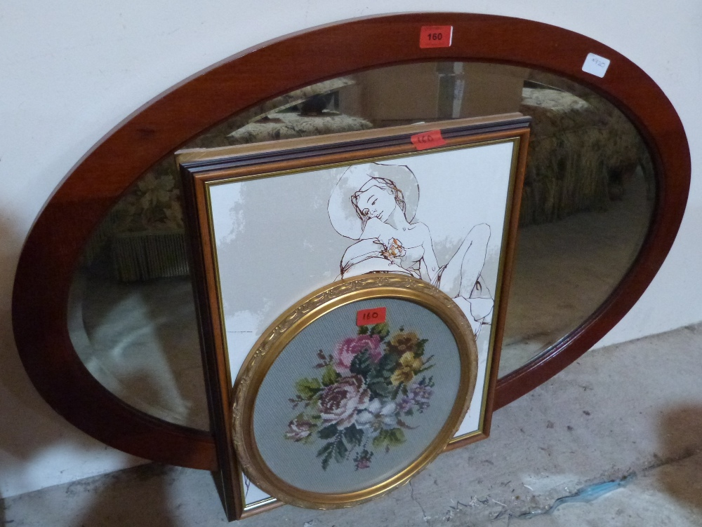 An oval wall mirror, a framed tapestry and a picture