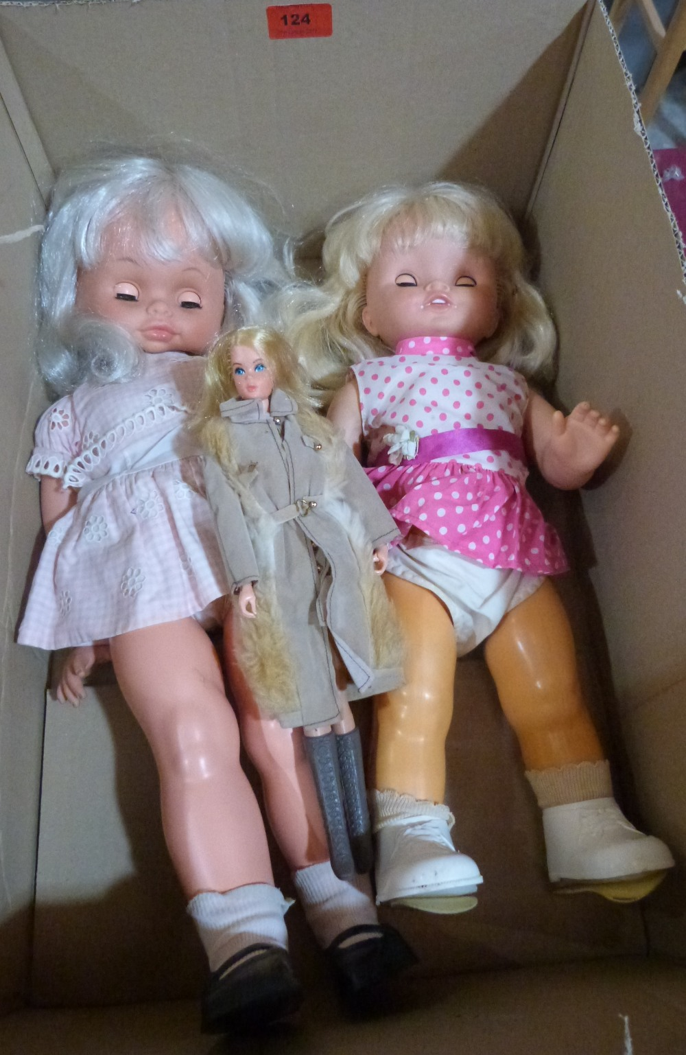 Vintage Toys. A 1960s Sindy doll with original clothes together with two larger vintage dolls with