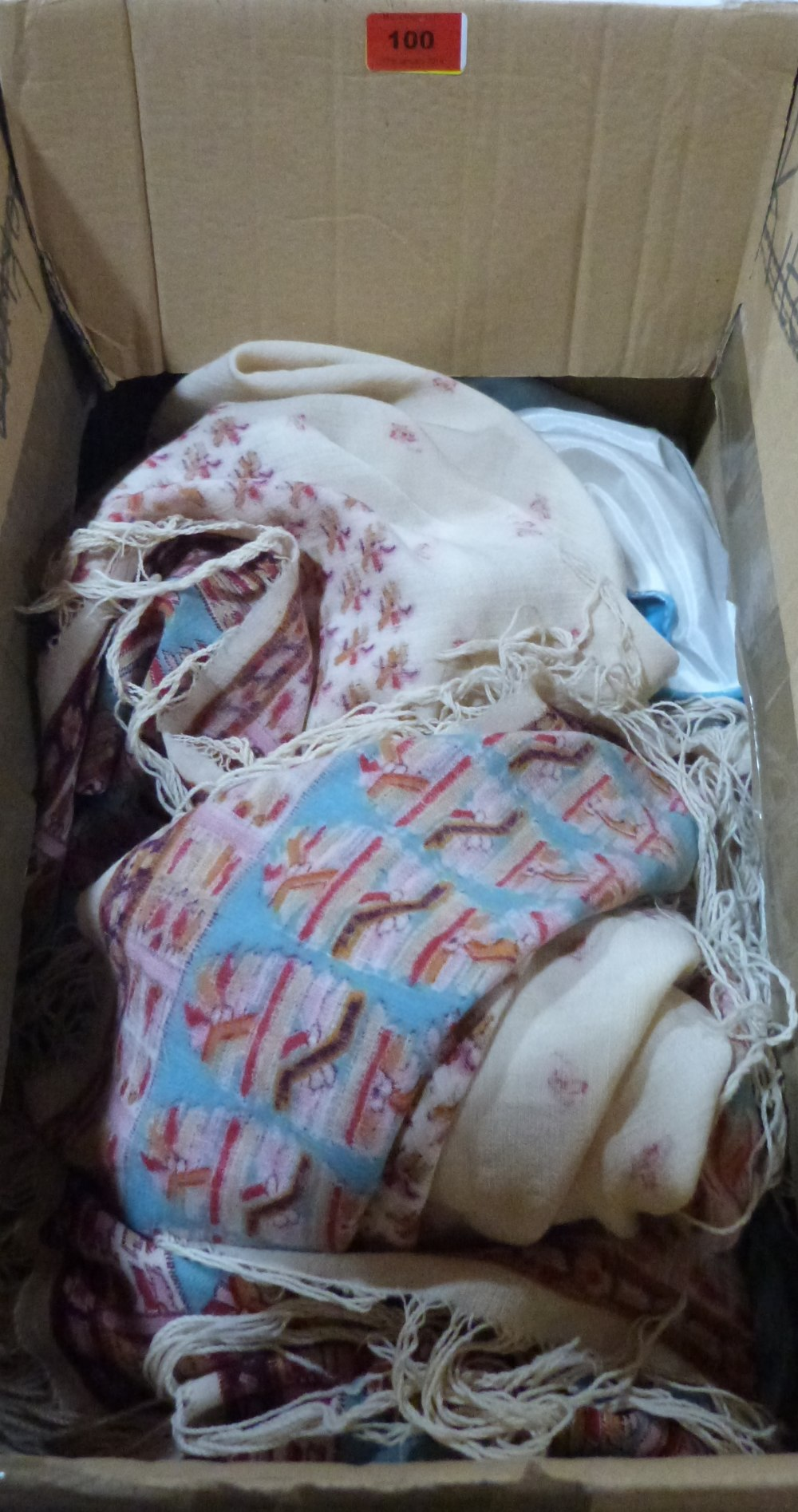 A box of shawls and other textiles