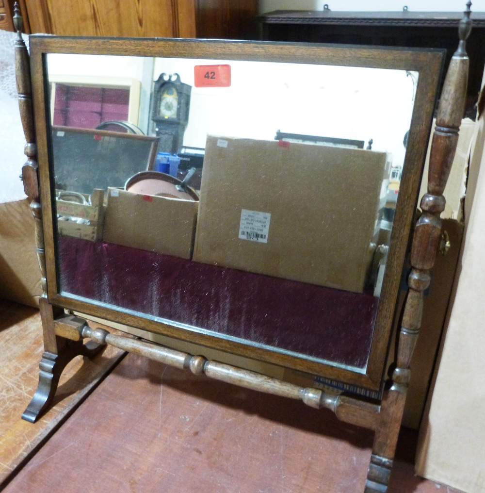 Lot 42 - A mahogany dressing table mirror. 21' high
