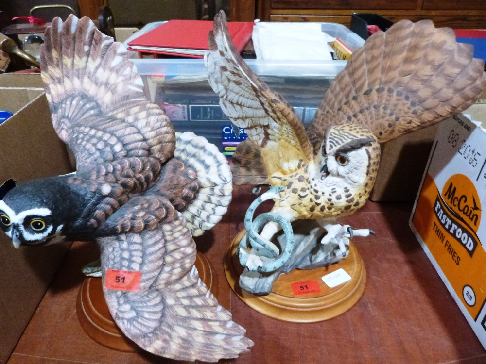 Lot 51 - Two bisque porcelain owl figures by The Franklin Mint. One with chipped wing