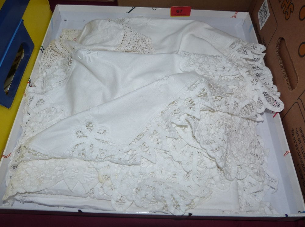 A linen lace table cloth with matching place setting for 12