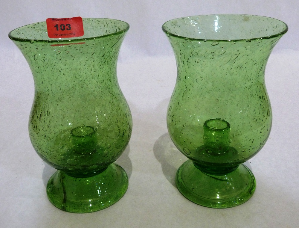 A pair of Victorian green glass storm candle holders. Possibly Bristol. 7' high. One re-stuck