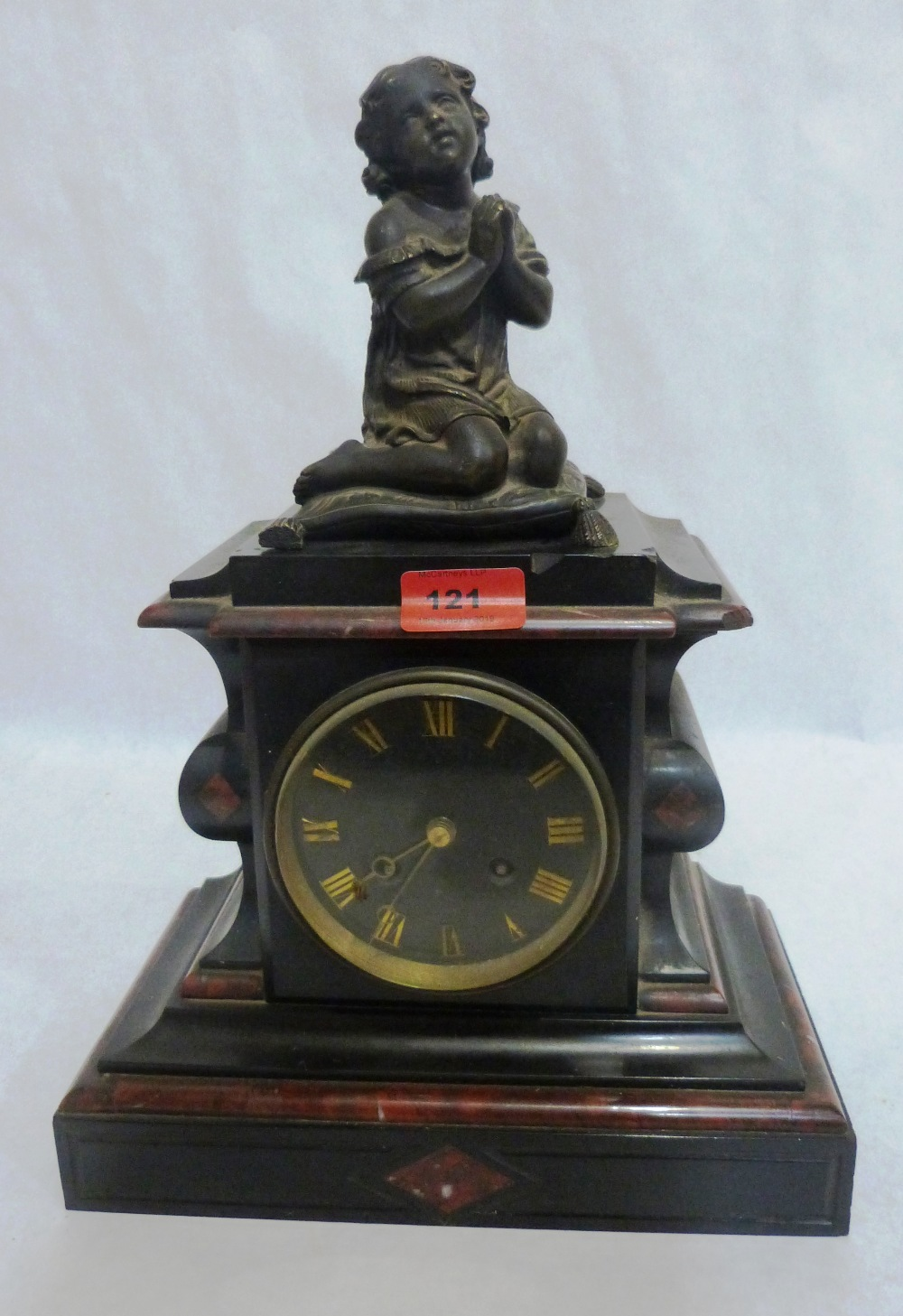 A French slate and marble mantle clock with drum movement striking on a bell, the case with bronze