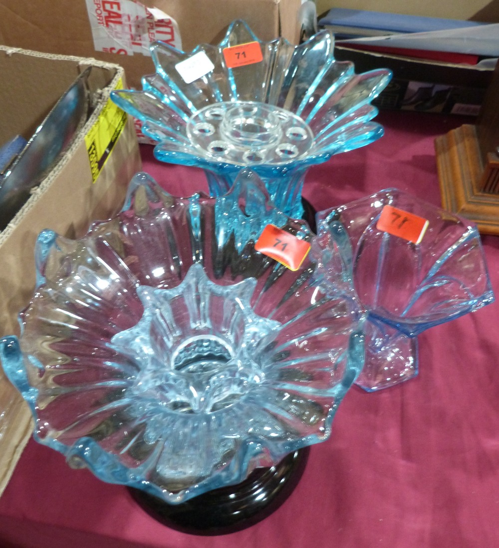 Three blue glass vases