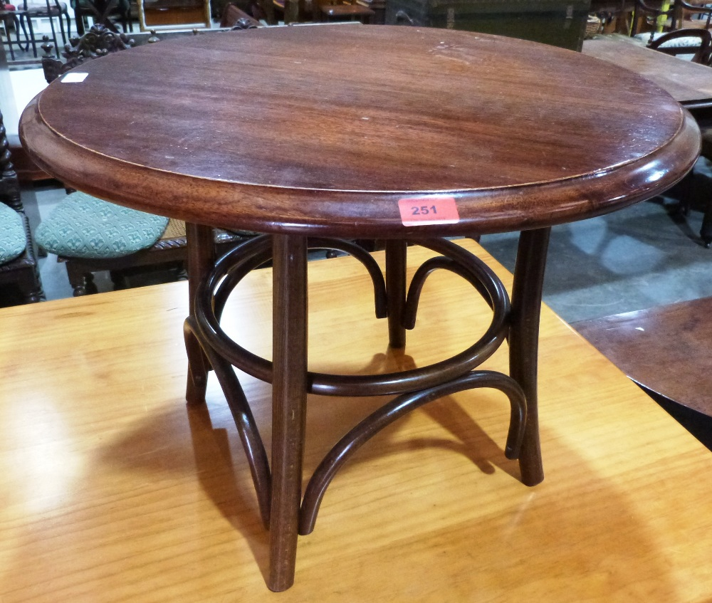 Lot 251 - A low table on bentwood support. 27' diam