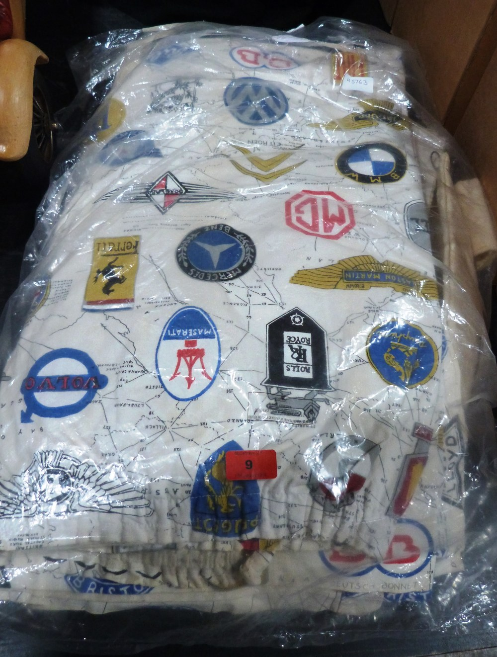 Lot 9 - A quantity of curtains, one pair printed with motorcar marque logos