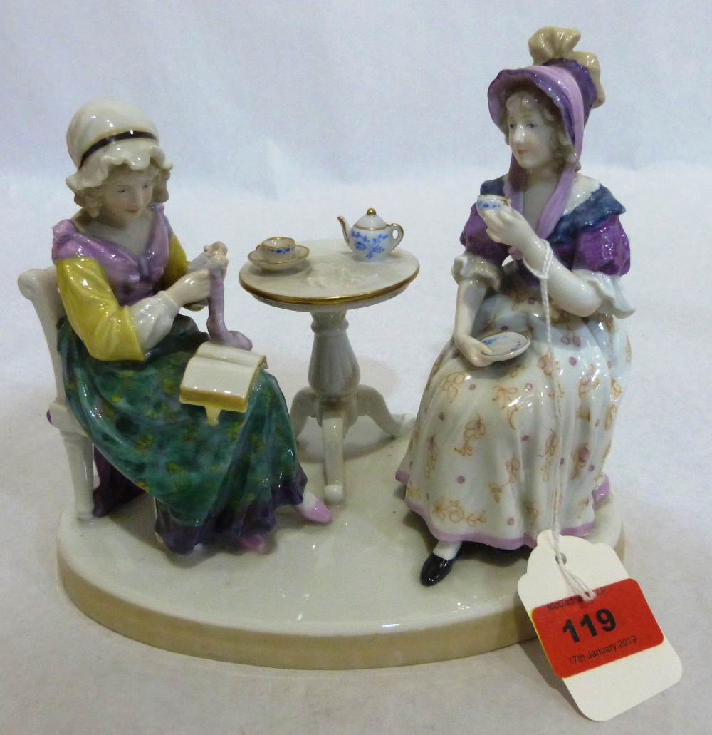 A continental porcelain group of two ladies sewing and taking tea. 7' high