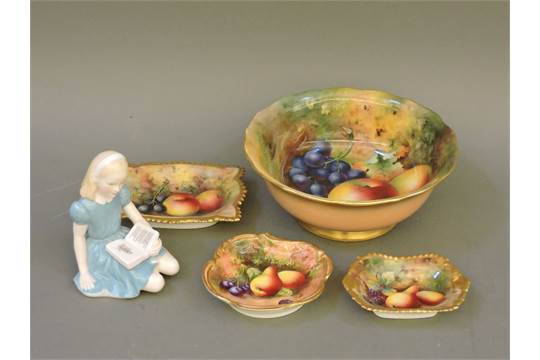 A Royal Worcester fruit bowl, decorated by H Ayrton, with apples and ...
