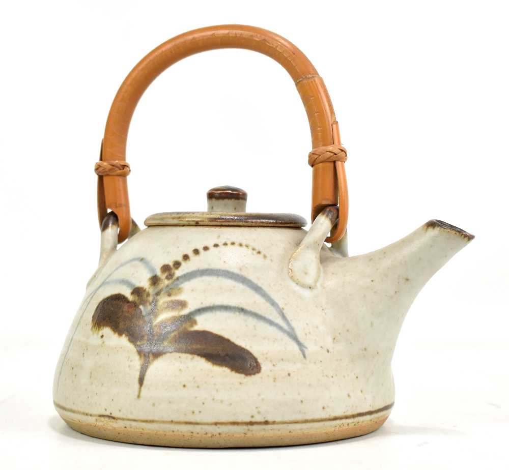 Lot 100 - Lowerdown Pottery; a stoneware teapot with cane handle, foxglove decoration on pale grey ground,