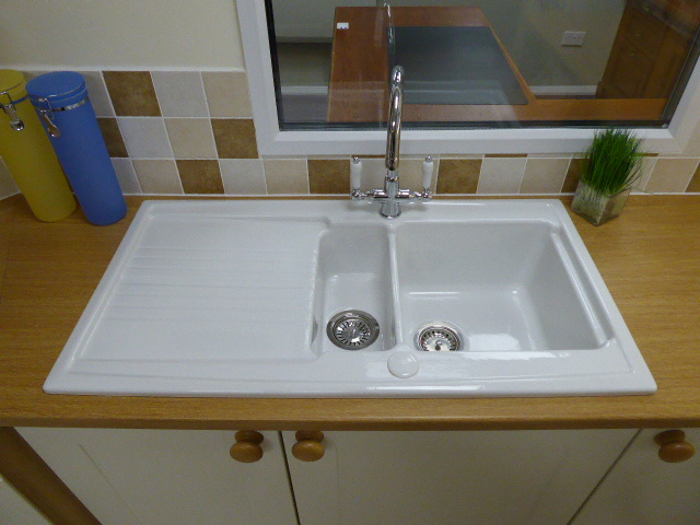 Lot 8 - Shaker alabaster kitchen with oak wood laminate worktops. Max measurement is 380cm x 210cm. With