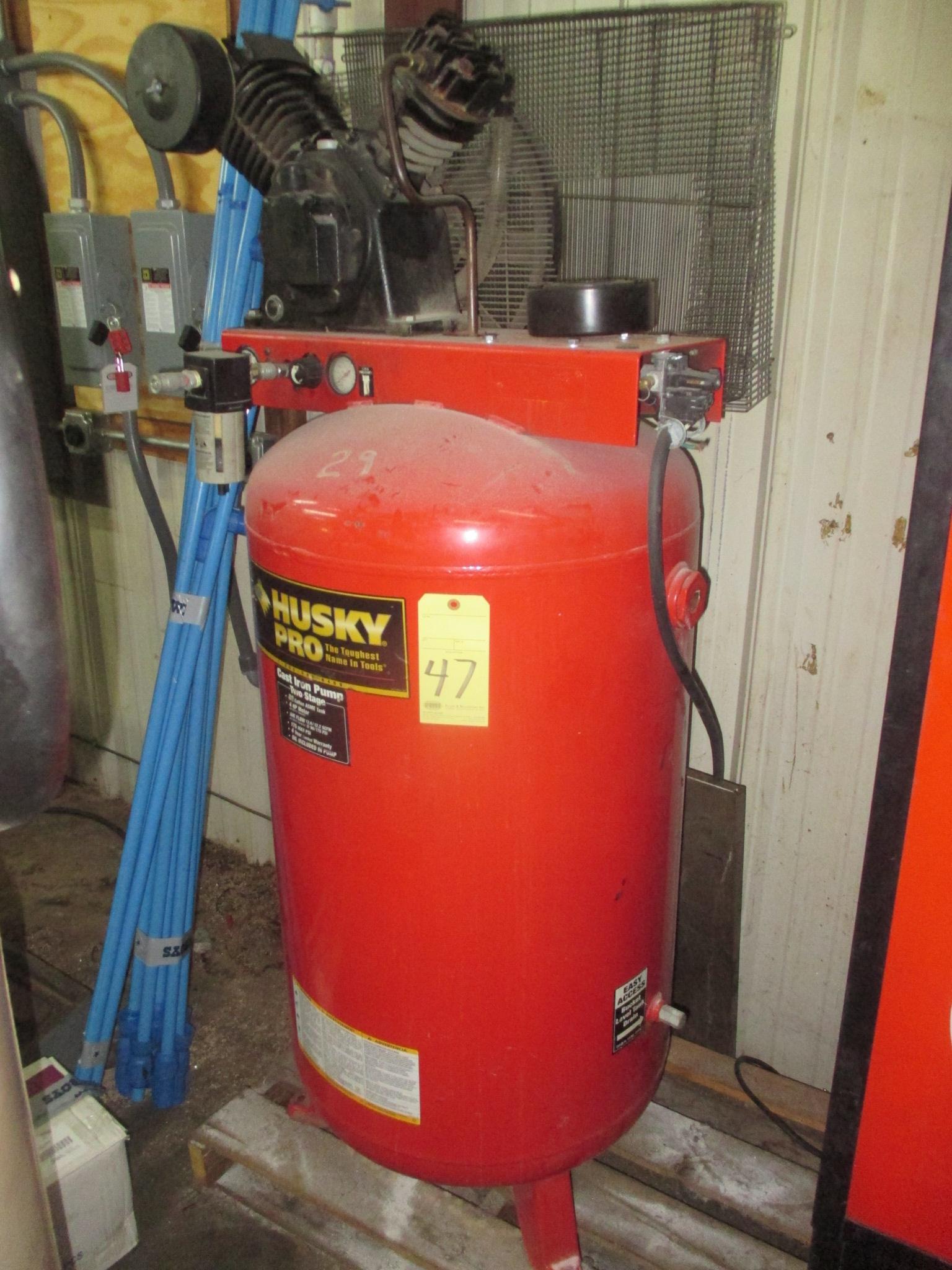 Lot 47 - RECIPROCATING TYPE AIR COMPRESSOR, HUSKY, 4 HP motor, 80 gal. vert. tank, 12.2 SCFM @ 90 PSI (