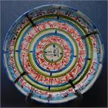 A Persian glazed ceramic bowl, decorated with bands of Islamic script, dated and marked to base, H.
