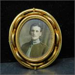 A 19th century pinchbeck brooch with double sided revolving picture frame, H.6cm, in associated box