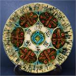 A Persian glazed ceramic dish, marked and dated to base, H.4cm Diameter 28cm