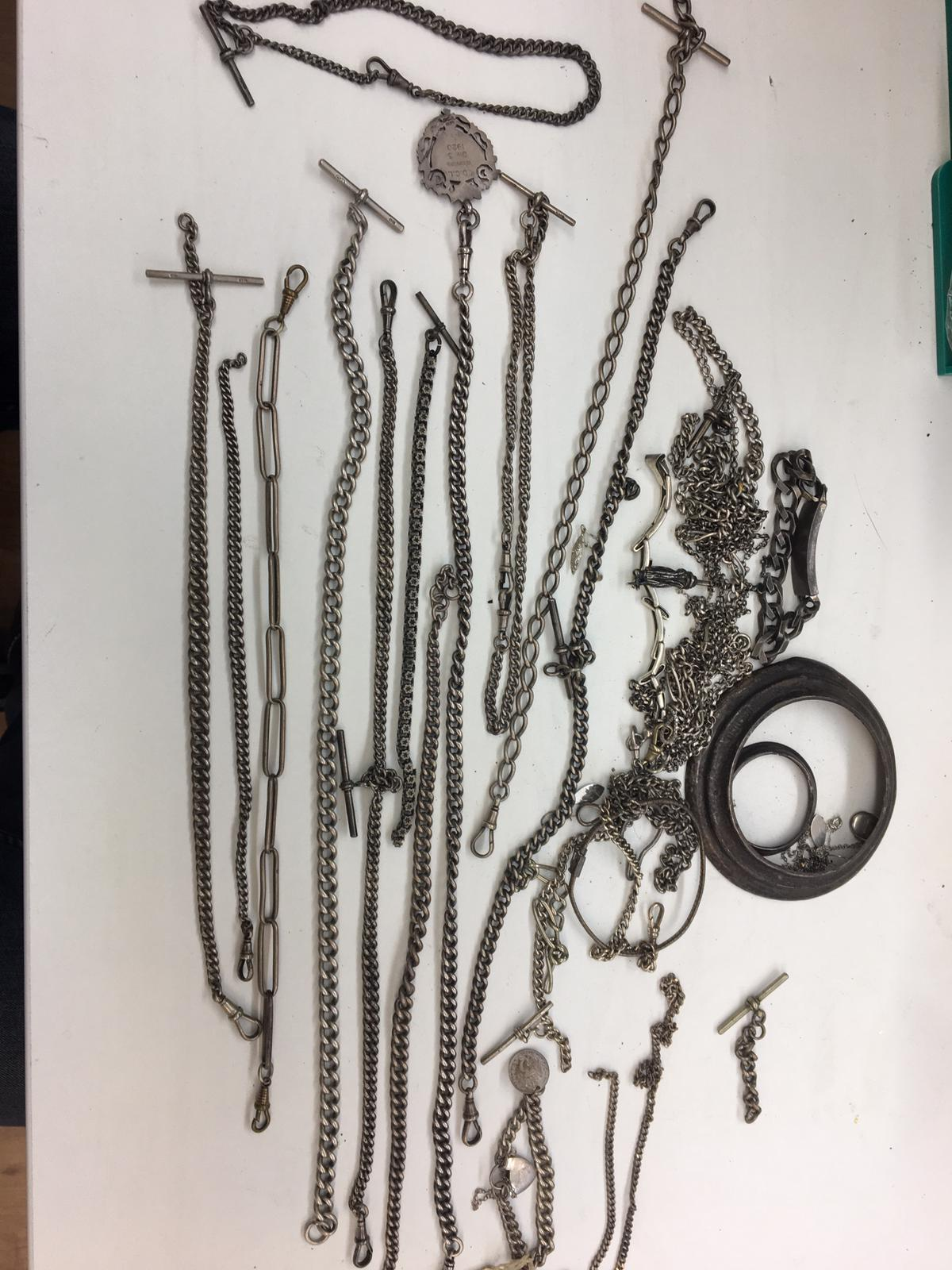 Large qty of silver Albert chains and bracelets, total weight 650 grams.