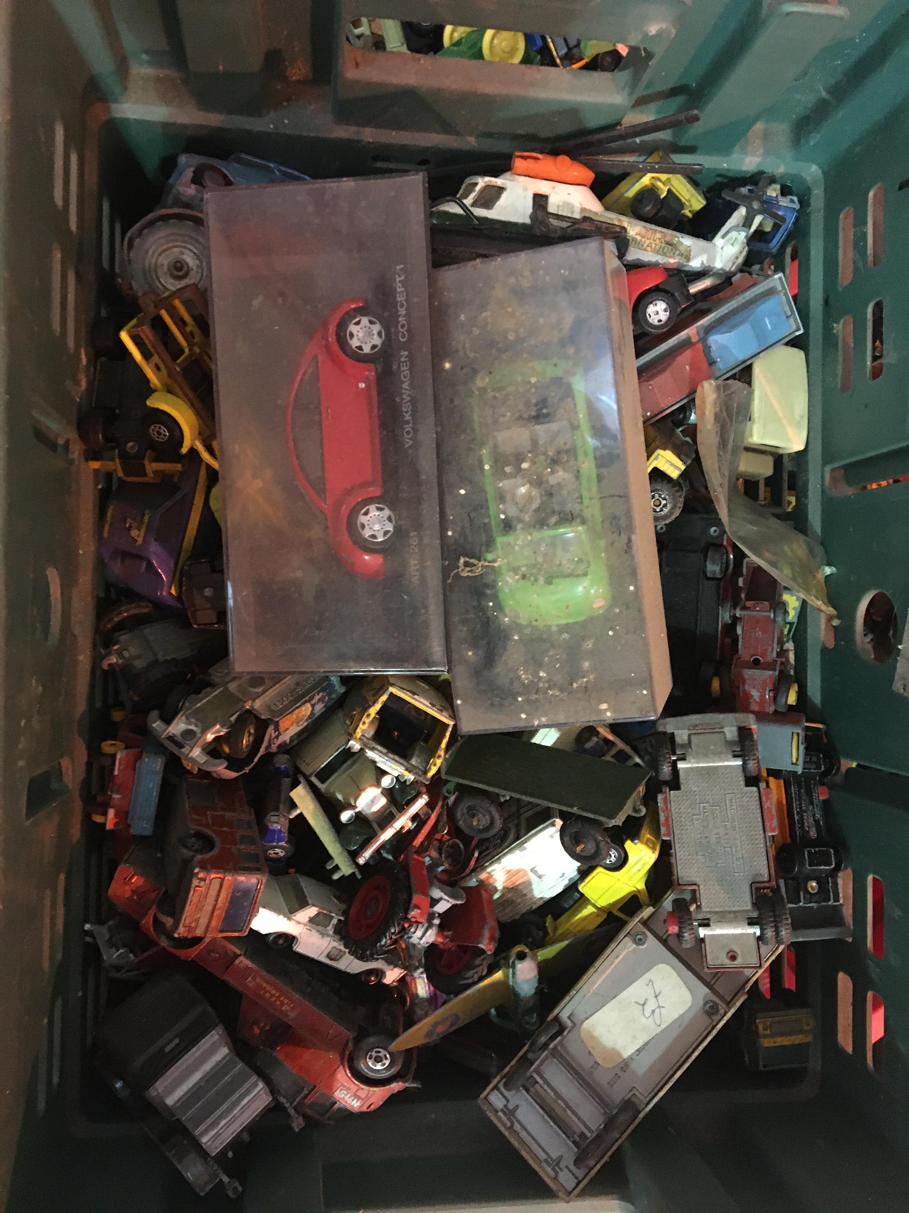 Box of vintage diecast cars.