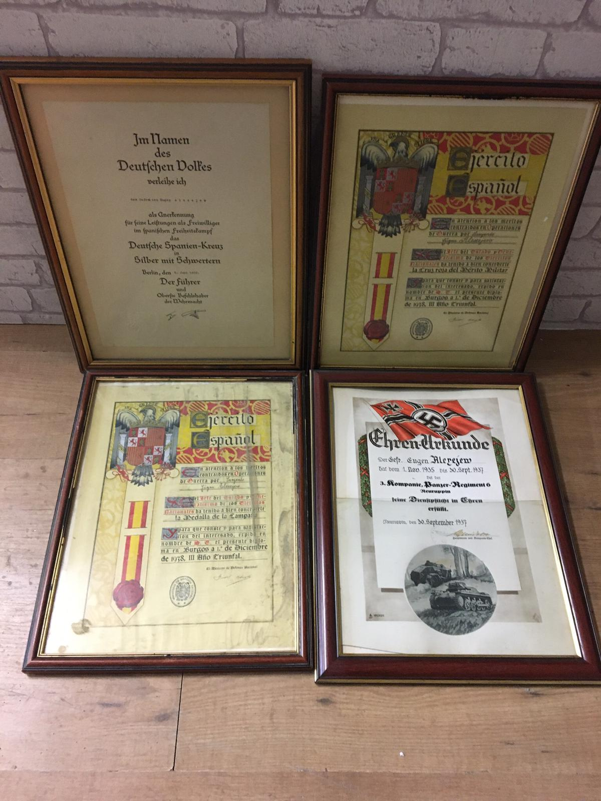 Four framed WWII German spanish order certificates.