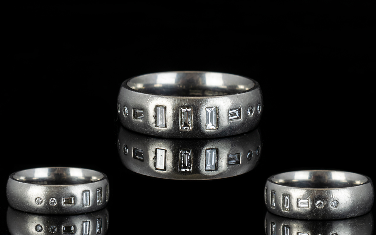 Lot 147 - Contemporary Platinum Band Set with Diam