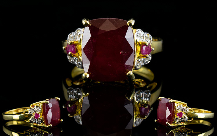 Lot 145 - Ruby Cushion Cut Solitaire Ring with rub