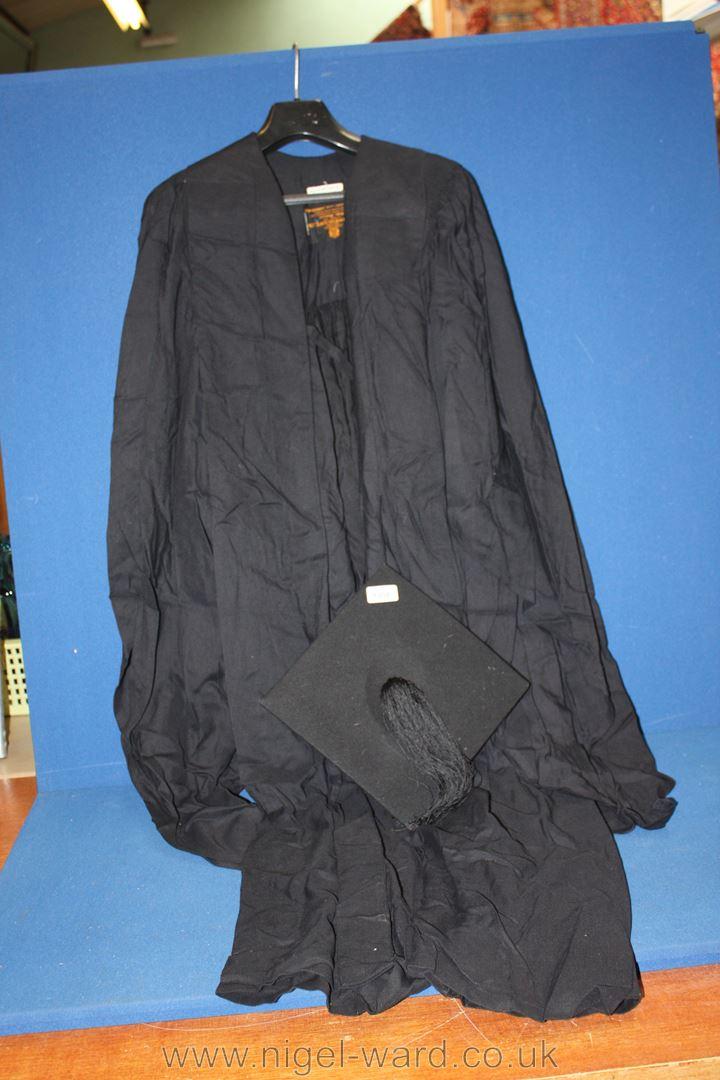 A Graduation Cap and Gown by Ede & Ravenscroft Ltd, cap size 6 1/2.