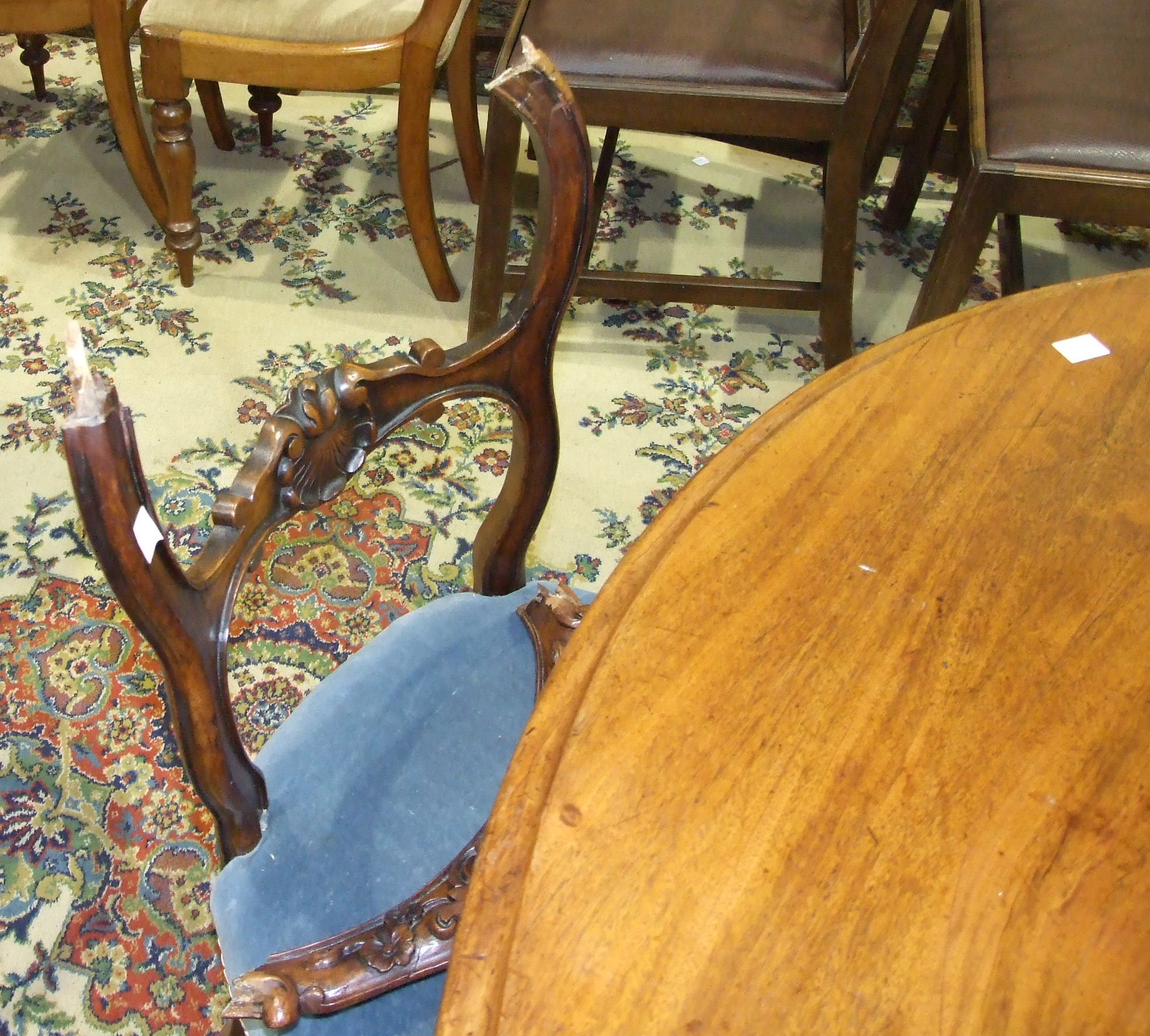 Lot 30 - A Victorian mahogany circular breakfast table with moulded border, on turned column and carved