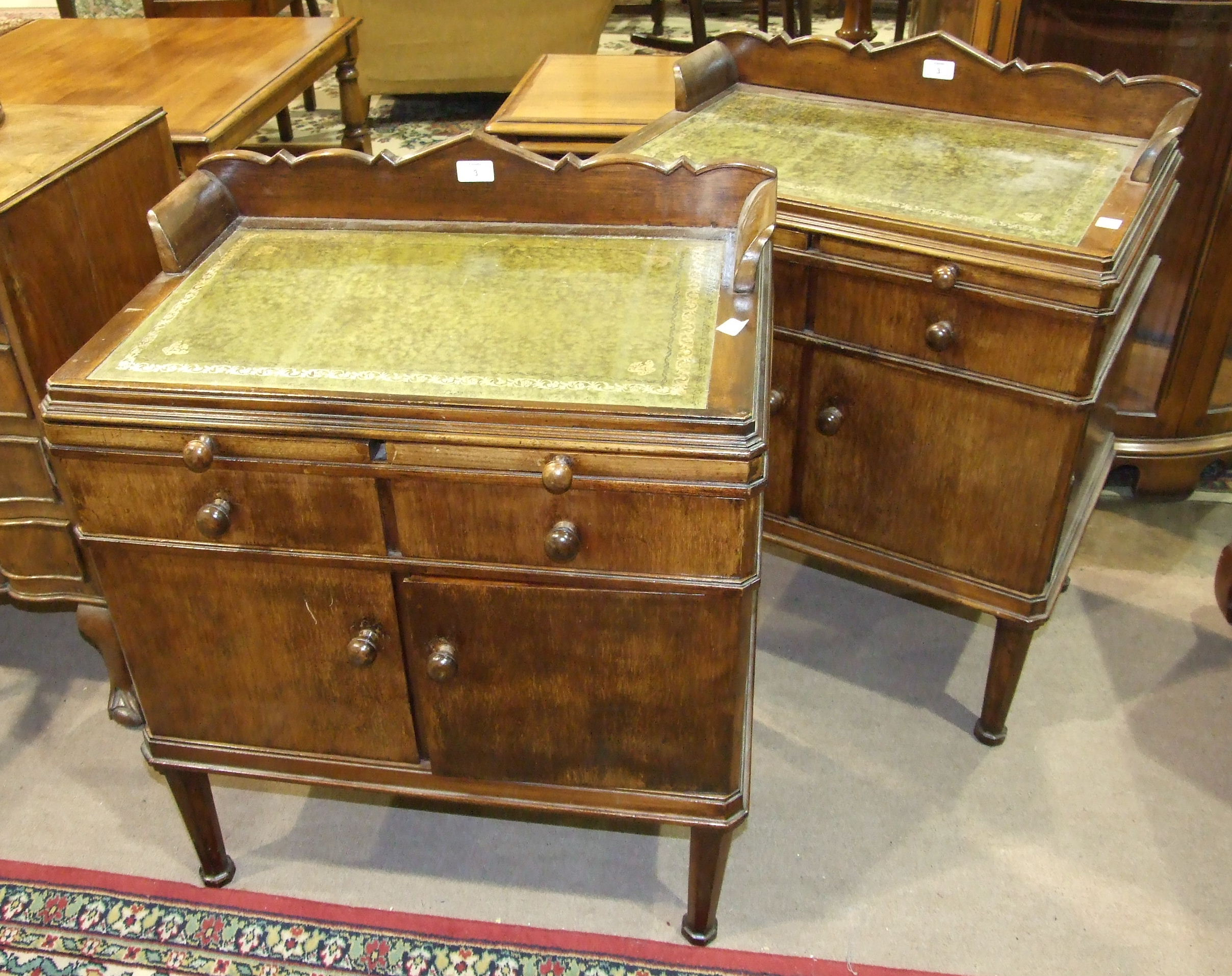 Lot 3 - A pair of stained wood low cupboards, each with a rectangular top and inset above two slides, two