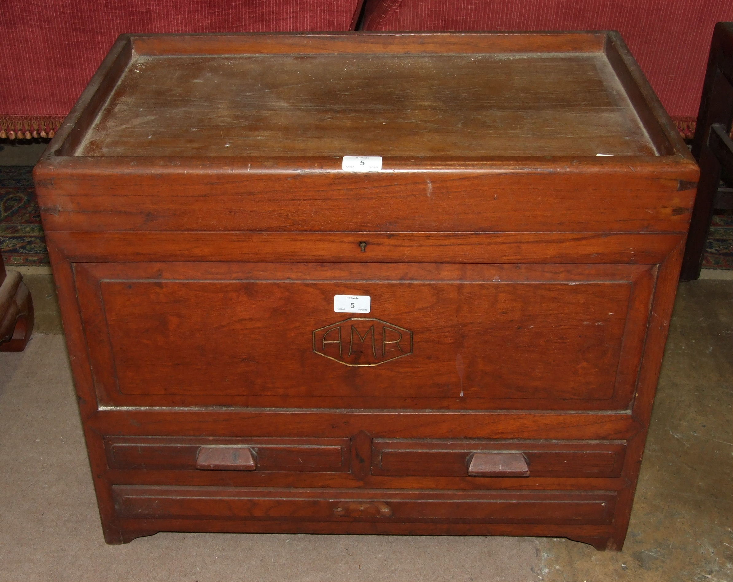Lot 5 - A small hardwood chest, the rectangular hinged lid above two small and one long drawers, 65cm