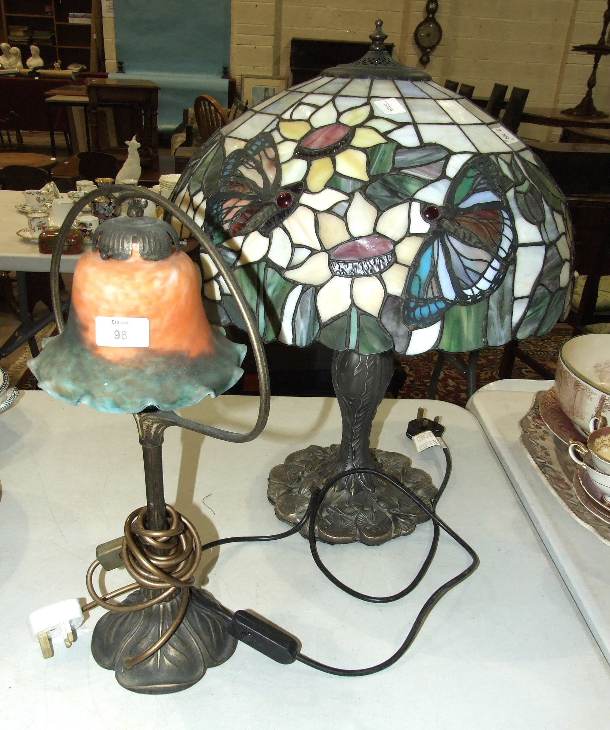 Lot 98 - A modern Tiffany style table lamp, the shade decorated with butterflies, 58cm high and another