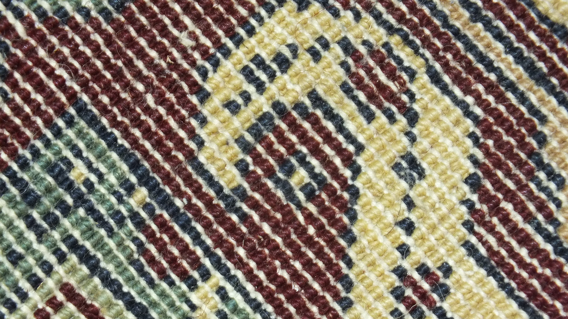 Lot 43 - A modern Oriental rug with geometric design on ivory and burgundy field, 220 x 140cm.
