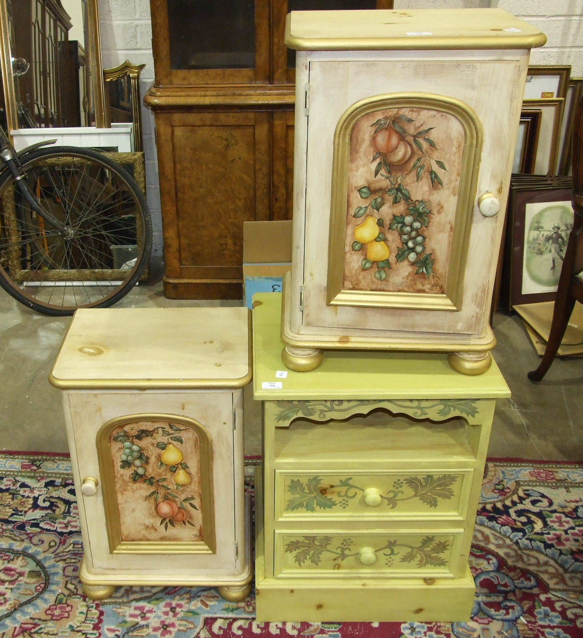 Lot 19 - A pair of painted wood bedside cabinets, and another painted bedside table with two drawers, (3).