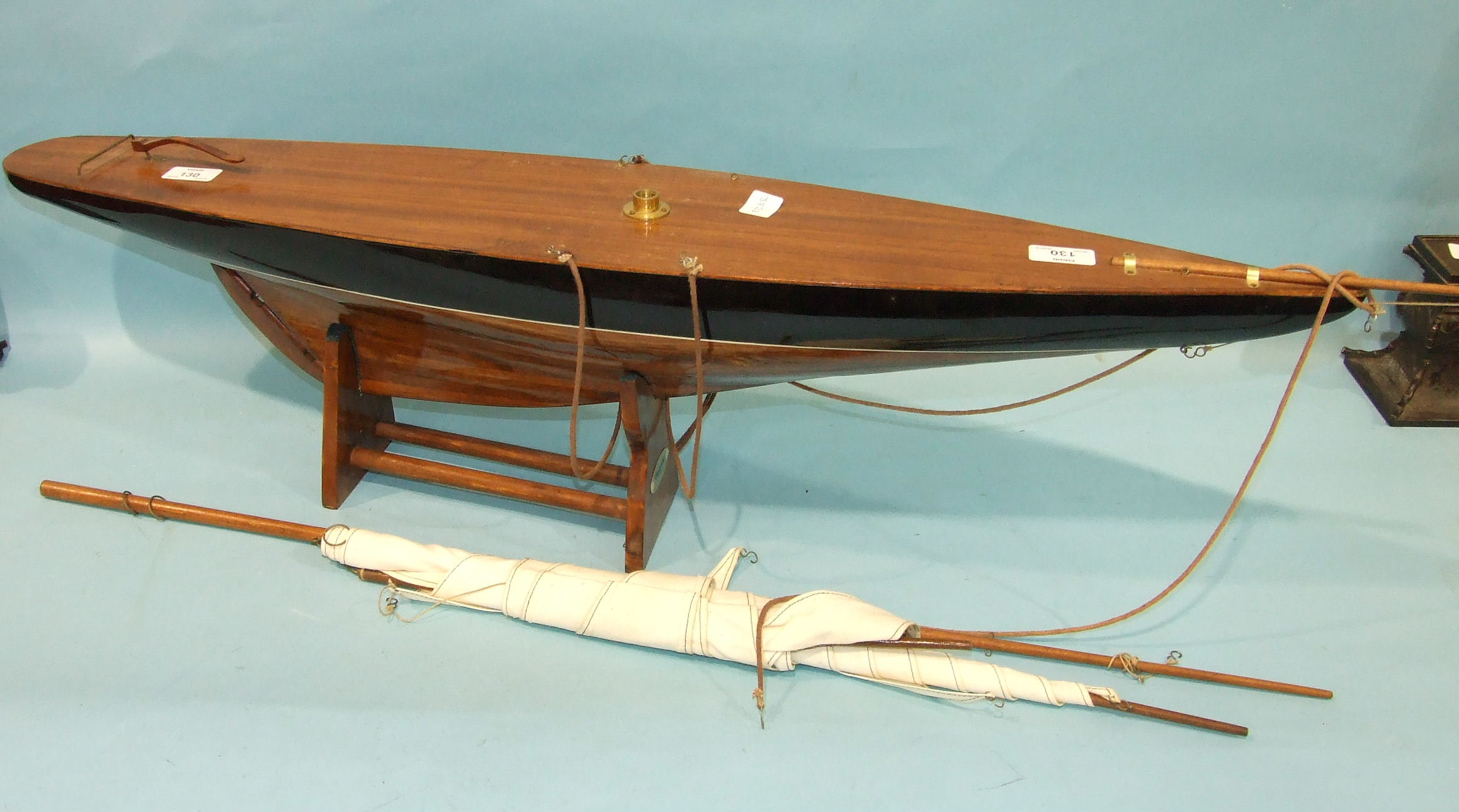 Lot 130 - A modern hardwood pond yacht painted black above the waterline, 100cm long.