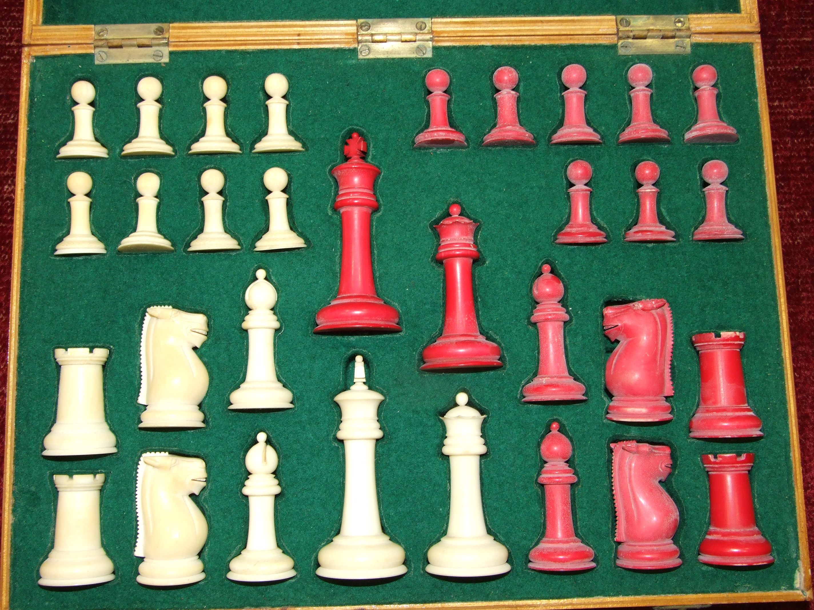 Lot 70 - An early 20th century Staunton style ivory chess set in later box, with board.