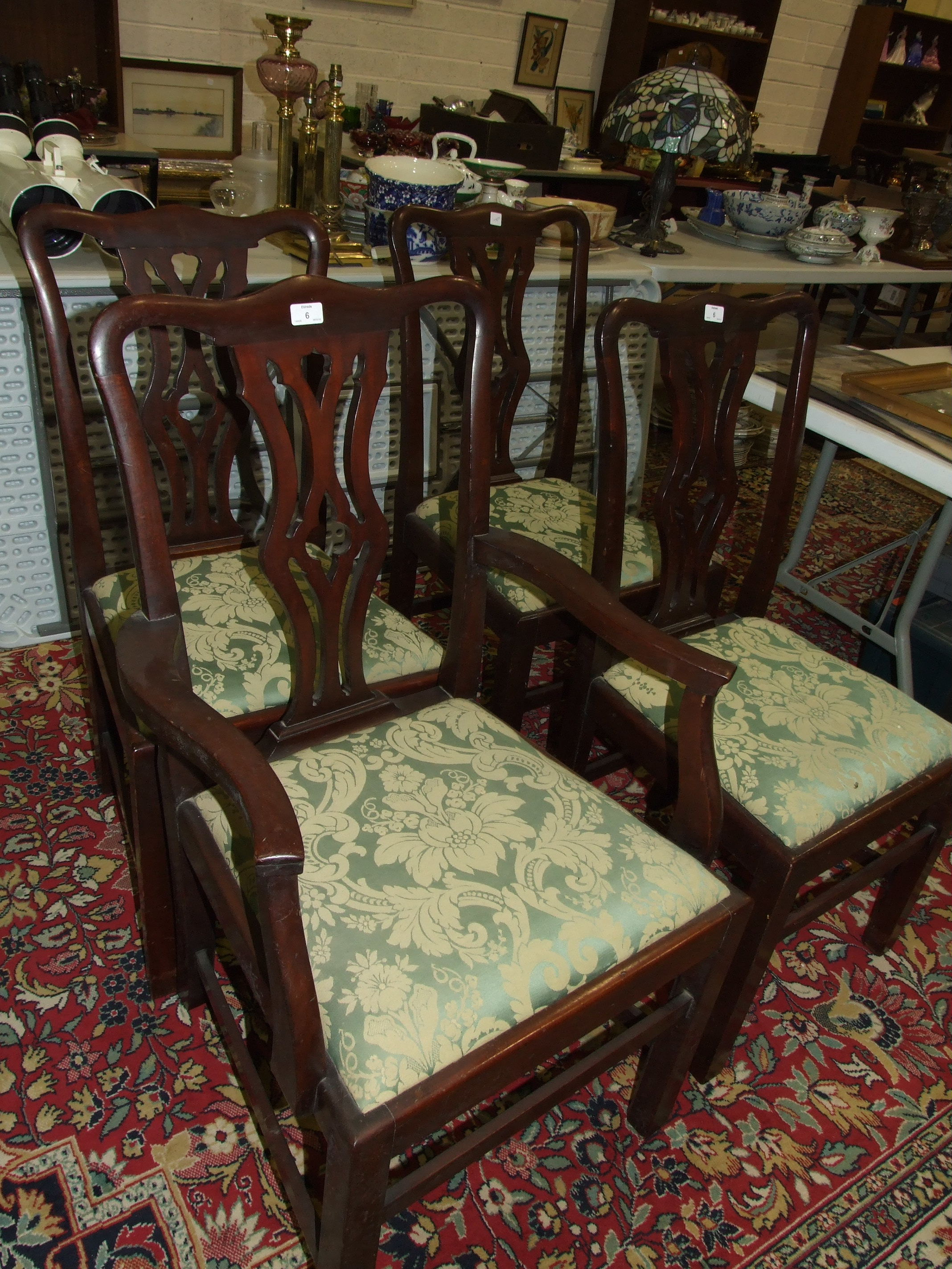 Lot 6 - A set of six 20th century hardwood Chippendale style dining chairs, each with pierced centre