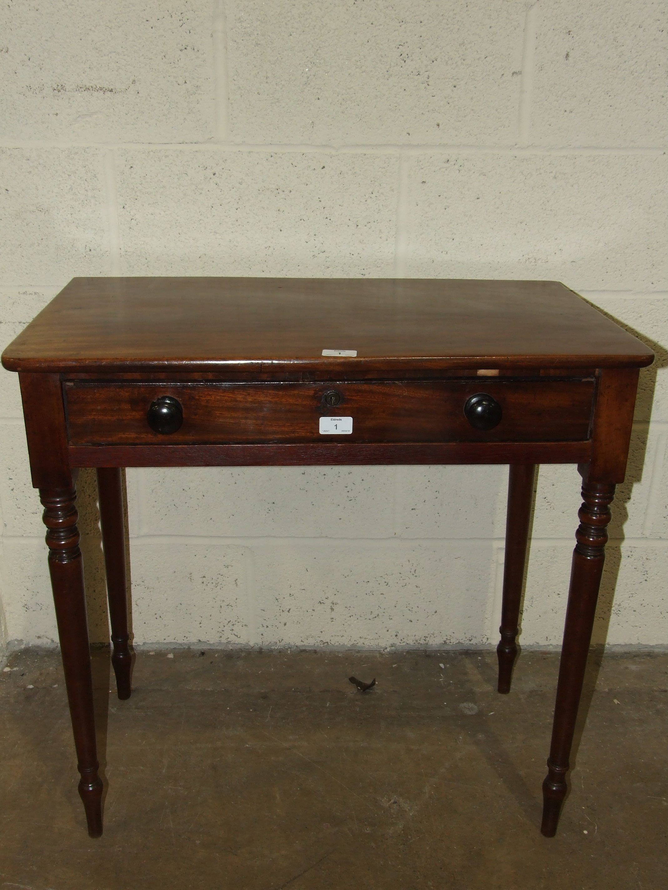 Lot 1 - A late 19th century mahogany hall table, the rectangular top above a frieze drawer, on turned