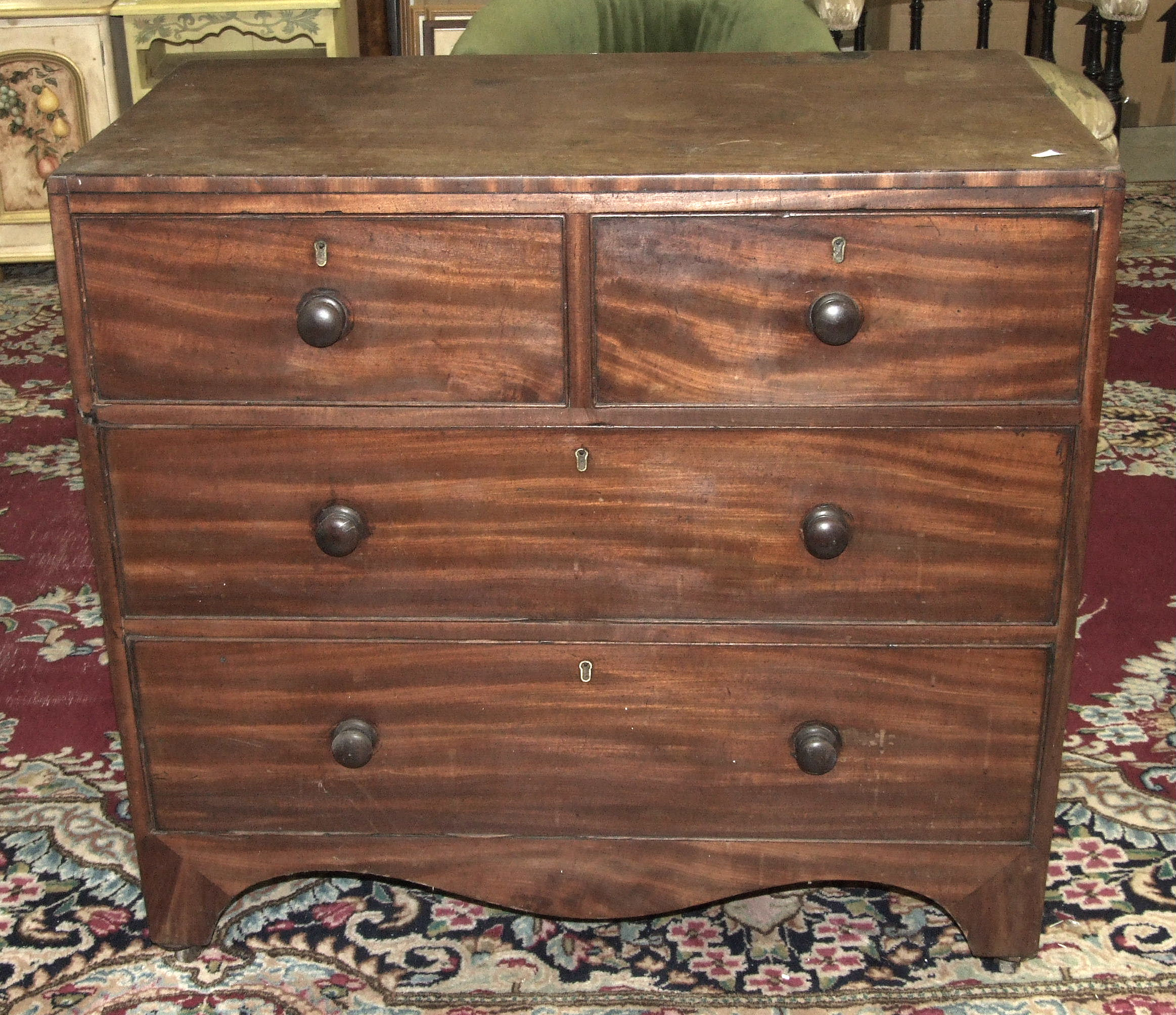 Lot 22 - A 19th century mahogany straight front chest of two short and two long drawers on bracket feet, 92cm