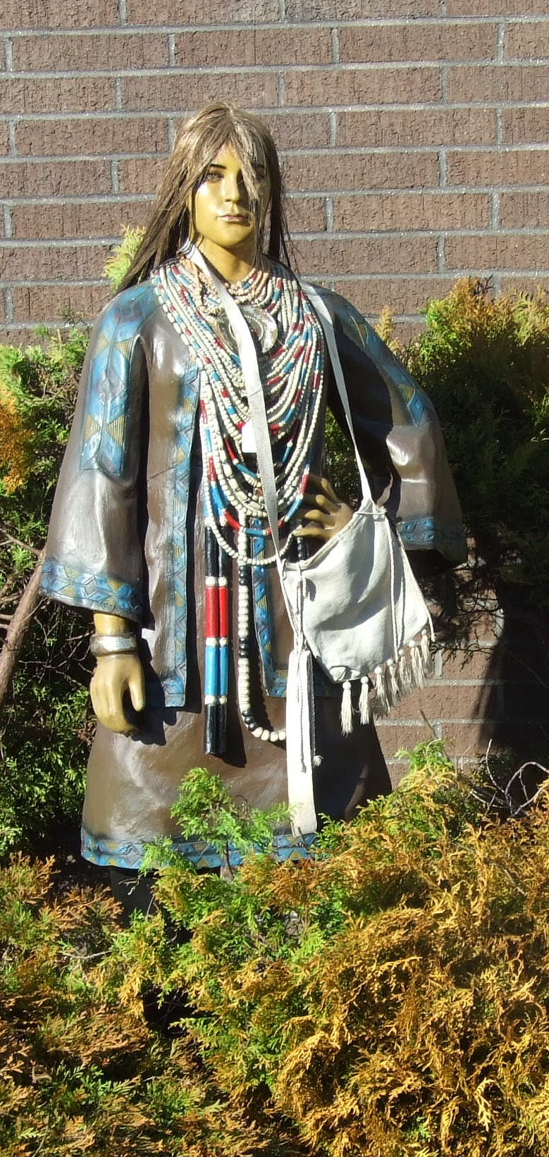 Lot 35 - A life-size moulded composite figure of an Indian squaw, with horse hair wig, 168cm high.