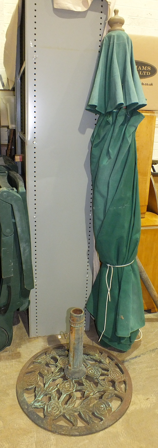 Lot 29 - A large garden parasol with stand.