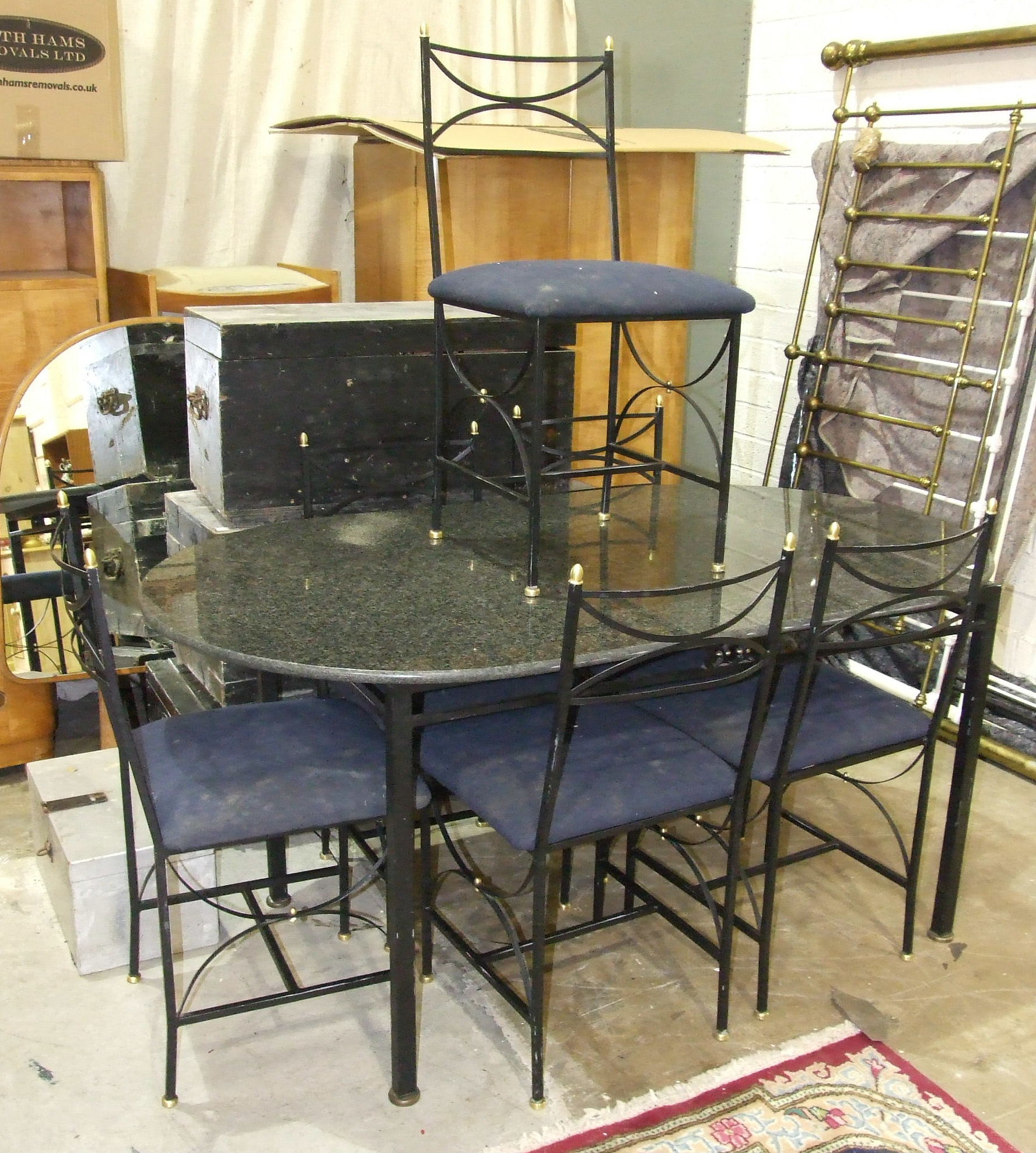 Lot 18 - A modern oval marble top table on metal stand, 159 x 89cm and six matching chairs with upholstered